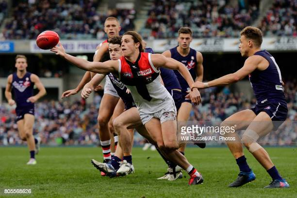 Jack Steele of the Saints juggles the ball during the round 15 AFL match between the Fremantle Dockers and the St Kilda Saints at Domain Stadium on...