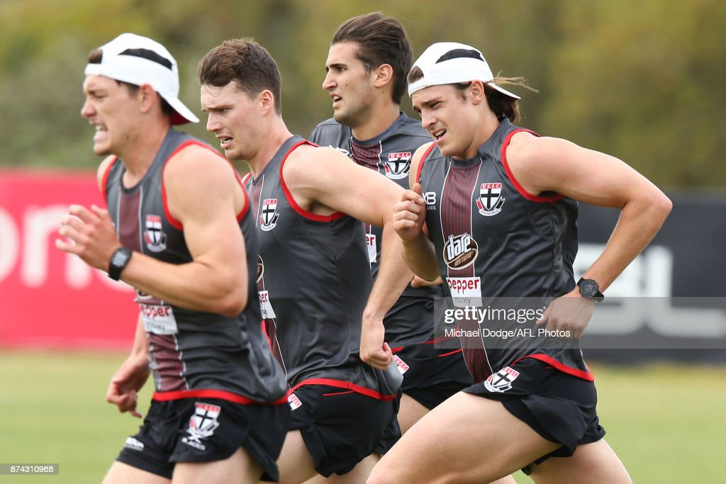Jack Steele (R) of the Saints runs laps during a St Kilda Saints AFL training session at Linen House Oval on November 15, 2017 in Melbourne, Australia.