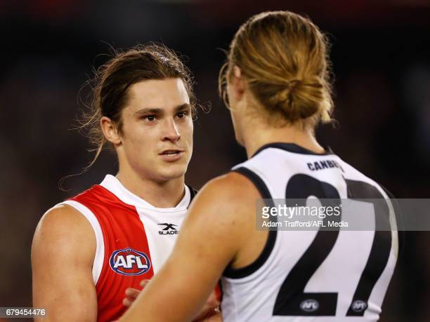 Jack Steele of the Saints shakes hands with former teammate Harrison Himmelberg of the Giants during the 2017 AFL round 07 match between the St Kilda...