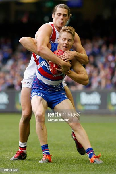 Jack Steele of the Saints tackles Lachie Hunter of the Bulldogs during the round 10 AFL match between the Western Bulldogs and the St Kilda Saints at...