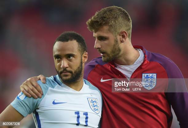 Jack Stephens of England consoles Nathan Redmond of England after he missed England's fifth penatly and sent them out of the tournament during the...