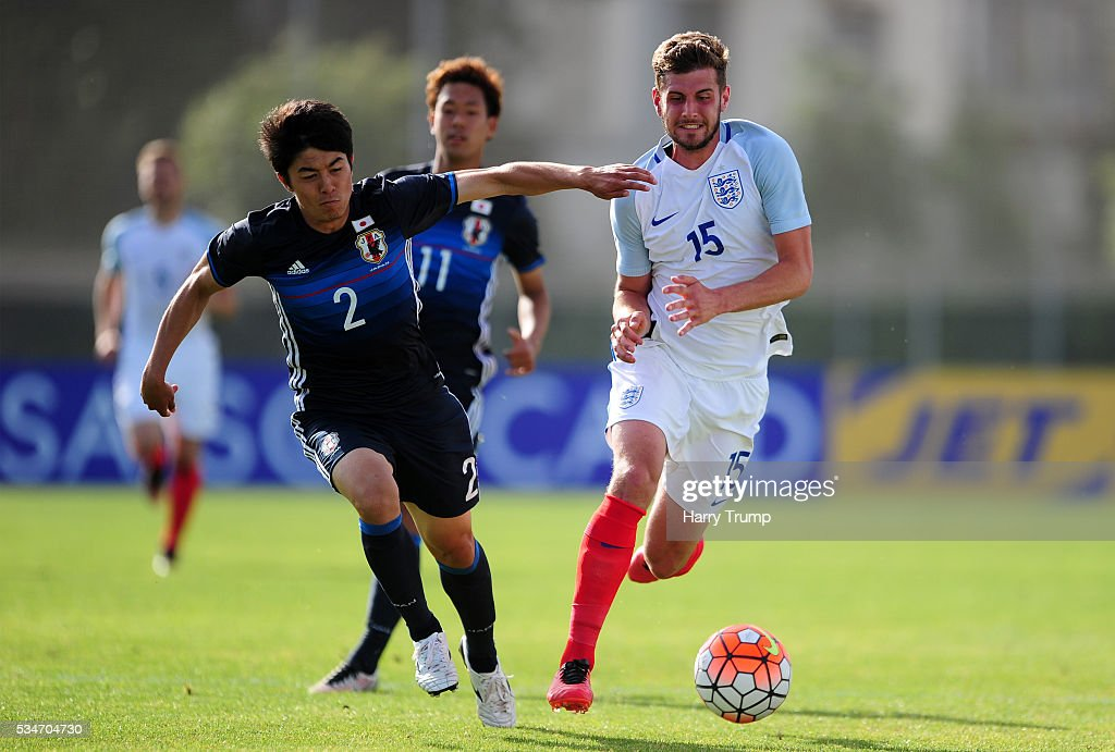 Jack Stephens of England is tackled by Sai Van Vermeskerken of Japan during the Toulon Tournament match between Japan and England at the Stade Leo Lagrange on May 27, 2016 in Toulon, France.