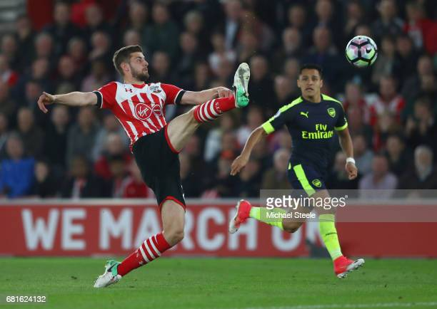 Jack Stephens of Southampton clears from Alexis Sanchez of Arsenal during the Premier League match between Southampton and Arsenal at St Mary's...
