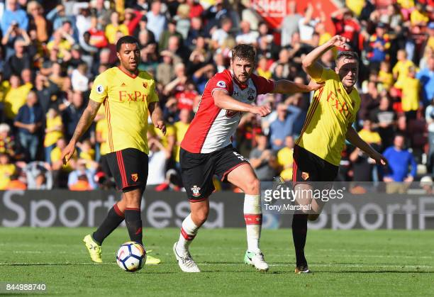 Jack Stephens of Southampton holds off a tackle by Tom Cleverley of Watford during the Premier League match between Southampton and Watford at St...