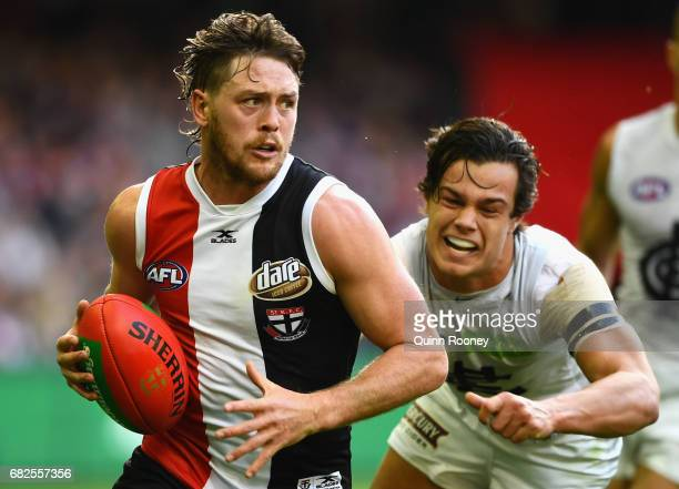 Jack Steven of the Saints breaks free of a tackle by Jack Silvagni of the Blues during the round eight AFL match between the St Kilda Saints and the...