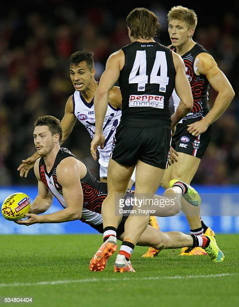 Jack Steven of the Saints handballs during the round 10 AFL match between the St Kilda Saints and the Fremantle Dockers at Etihad Stadium on May 28...