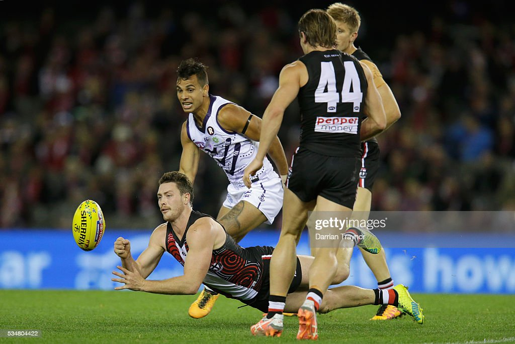 Jack Steven of the Saints handballs during the round 10 AFL match between the St Kilda Saints and the Fremantle Dockers at Etihad Stadium on May 28, 2016 in Melbourne, Australia.