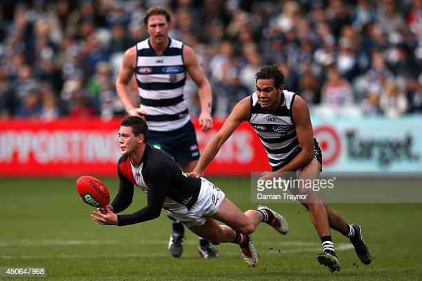 Jack Steven of the Saints handballs during the round 13 AFL match between the Geelong Cats and the St Kilda Saints at Skilled Stadium on June 15 2014...