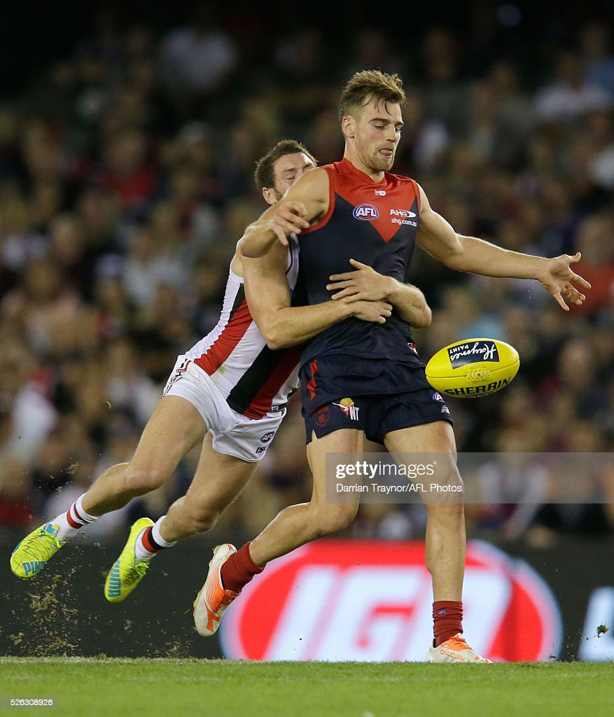 Jack Steven of the Saints tackles Dom Tyson of the Demons during the round six AFL match between the Melbourne Demons and the St Kilda Saints at Etihad Stadium on April 30, 2016 in Melbourne, Australia.