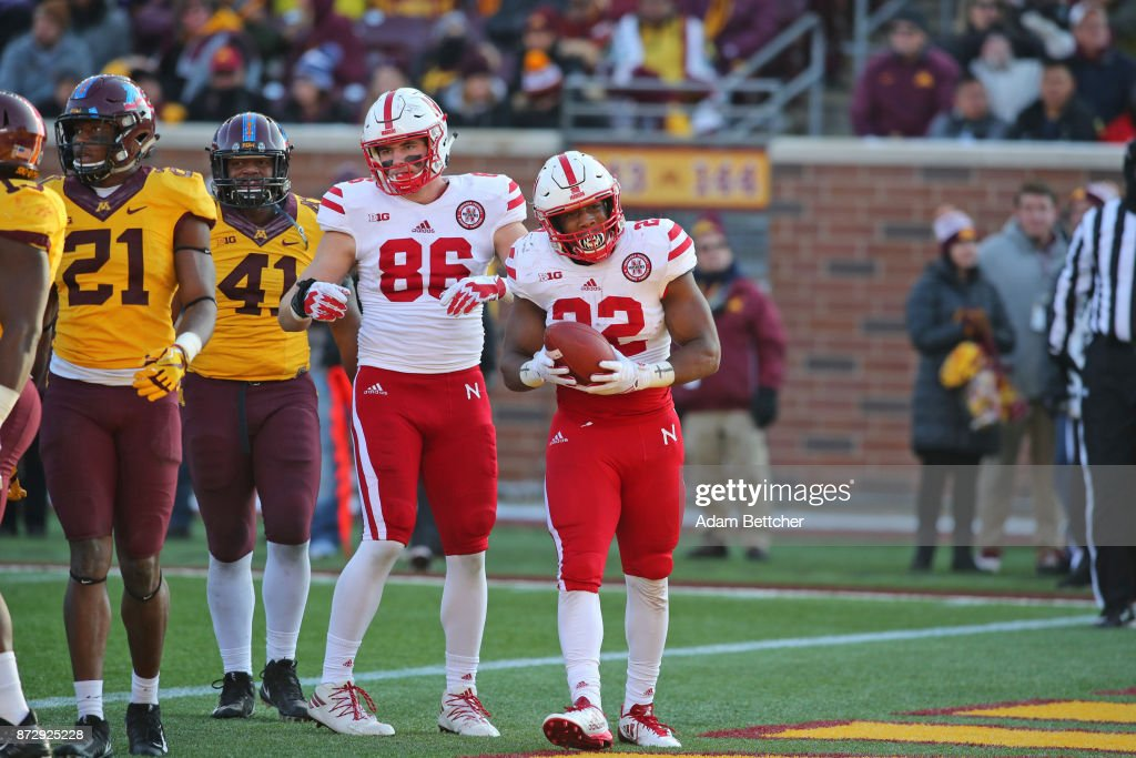 Jack Stoll #86 and Devine Ozigbo #22 of the Nebraska Cornhuskers celebrate a touchdown in the fourth quarter against the Minnesota Golden Gophers at TCF Bank Stadium on November 11, 2017 in Minneapolis, Minnesota. Minnesota defeated Nebraska 54-21.