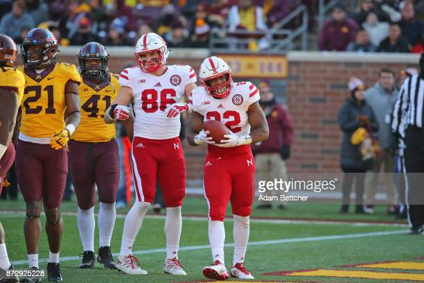 Jack Stoll and Devine Ozigbo of the Nebraska Cornhuskers celebrate a touchdown in the fourth quarter against the Minnesota Golden Gophers at TCF Bank...