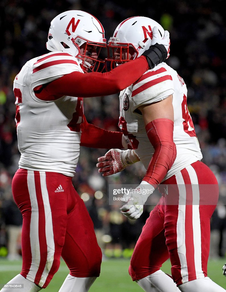 Jack Stoll #86 of the Nebraska Cornhuskers and Tyler Hoppes #88 of the Nebraska Cornhuskers celebrate after Hoppes scored a touchdown in the fourth quarter of the game between the Purdue Boilermakers and the Nebraska Cornhuskers at Ross-Ade Stadium on October 28, 2017 in West Lafayette, Indiana.