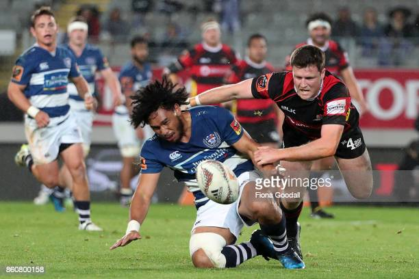 Jack Stratton of Canterbury tackles Taleni Seu of Auckland during the round nine Mitre 10 Cup match between Auckland and Canterbury at Eden Park on...