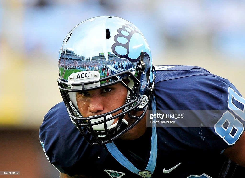 Jack Tabb #80 of the North Carolina Tar Heels wears the team's new chrome helmet against the North Carolina State Wolfpack during play at Kenan Stadium on October 27, 2012 in Chapel Hill, North Carolina. North Carolina won 43-35.