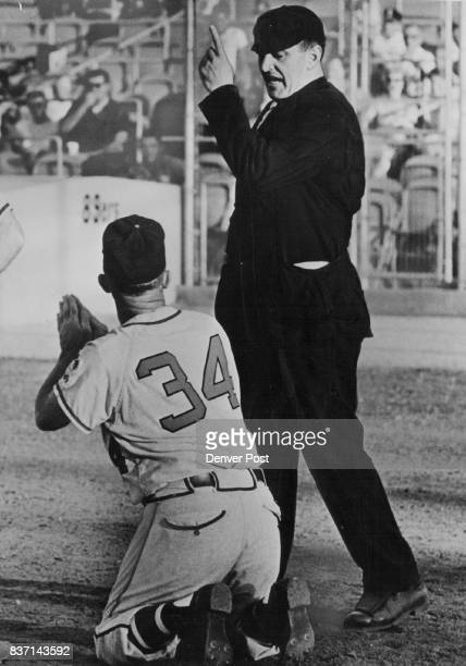 T LIKE YOU Jack Tighe new field manager of the Denver Bears gets the heave ho from umpire Walt Peters during the 1962 American Association baseball...
