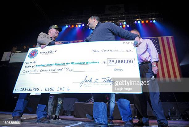 Jack Tilley presents a check for the Boulder Creek Retreat for Wounded Warriors during the 2011 American Freedom Festival at The George Mason...