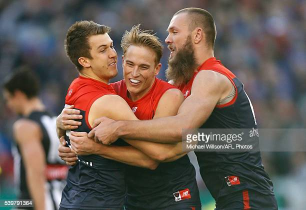 Jack Trengove Bernie Vince and Max Gawn of the Demons celebrate during the 2016 AFL Round 12 match between the Melbourne Demons and the Collingwood...
