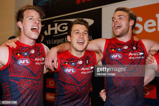 Jack Trengove sing the club song after winning with Mitch Hannan and Jack Watts of the Demons during the round 18 AFL match between the Melbourne...