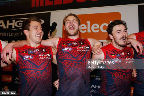 Jack Trengove sings the club song after winning with Jack Watts and Michael Hibberd of the Demons of the Demons during the round 18 AFL match between...