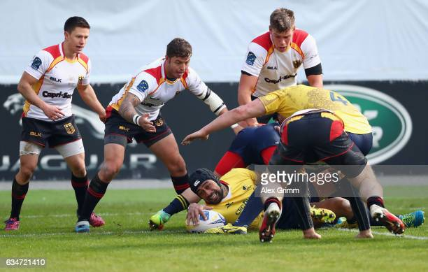Jack Umaga of Romania is challenged by Tim Menzel Raynor Parkinson and Sebastian Ferreira of Germany during the European Shield Rugby match between...