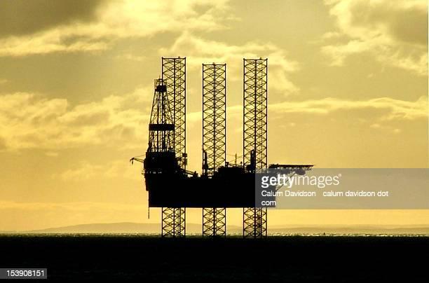 Jack up oil rig  at dawn