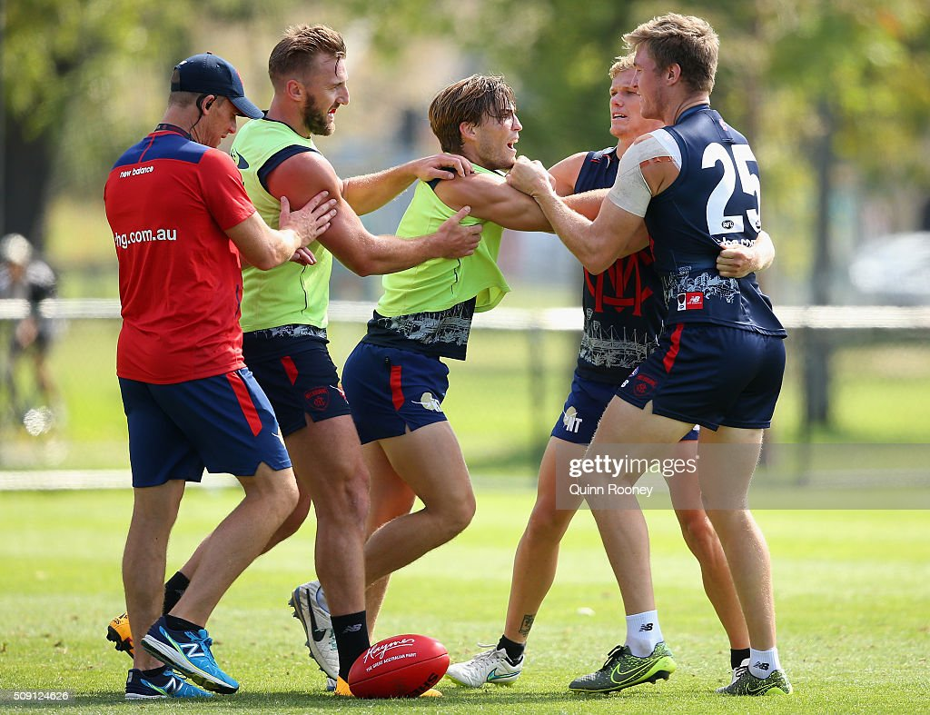 <a gi-track='captionPersonalityLinkClicked' href=/galleries/search?phrase=Jack+Viney&family=editorial&specificpeople=8280691 ng-click='$event.stopPropagation()'>Jack Viney</a> and Tom McDonald of the Demons push and shove each other during a Melbourne Demons AFL pre-season training session at Gosch's Paddock on February 9, 2016 in Melbourne, Australia.