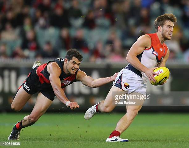Jack Viney of the Demons beats the tackle of Paddy Ryder of the Bombers during the round 13 AFL match between the Essendon Bombers and the Melbourne...