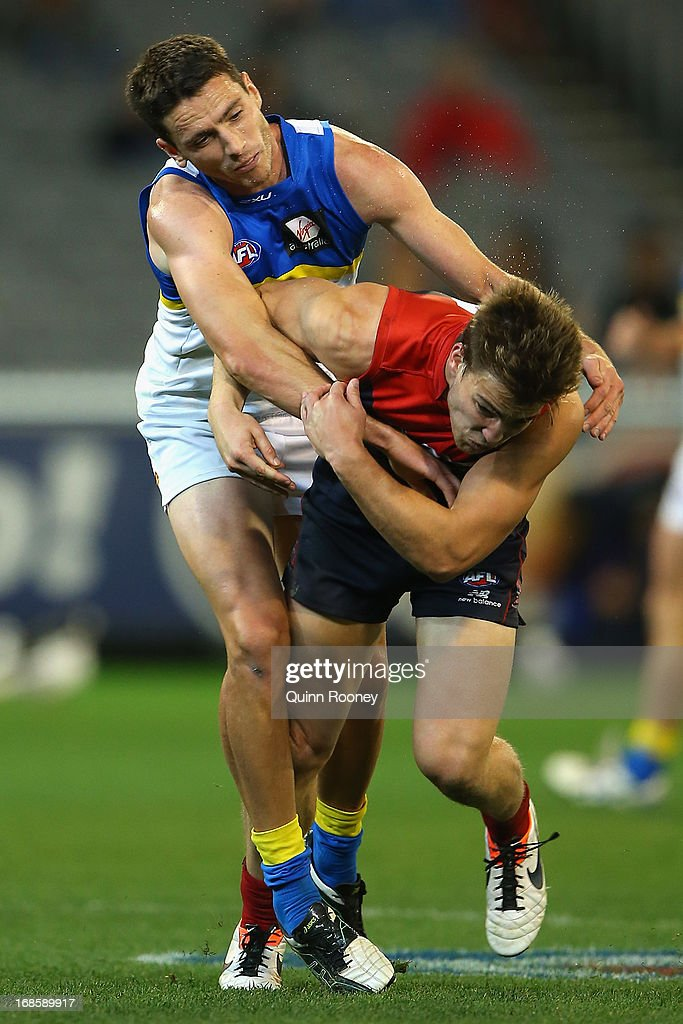 Jack Viney of the Demons collides with Thomas Murphy of the Suns during the round seven AFL match between the Melbourne Demons and the Gold Coast Suns at Melbourne Cricket Ground on May 12, 2013 in Melbourne, Australia.