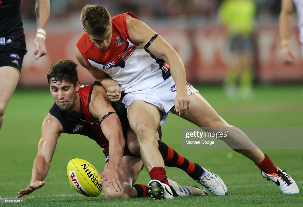 Jack Viney (R) of the Demons contests for the ball against David Myers of the Bombers during the round two AFL match between the Essendon Bombers and the Melbourne Demons at Melbourne Cricket Ground on April 6, 2013 in Melbourne, Australia.