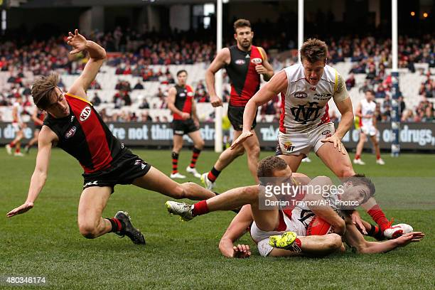Jack Viney of the Demons gathers the ball during the round 15 AFL match between the Essendon Bombers and the Melbourne Demons at Melbourne Cricket...