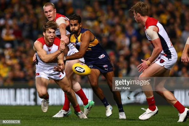 Jack Viney of the Demons handballs during the round 14 AFL match between the West Coast Eagles and the Melbourne Demons at Domain Stadium on June 24...