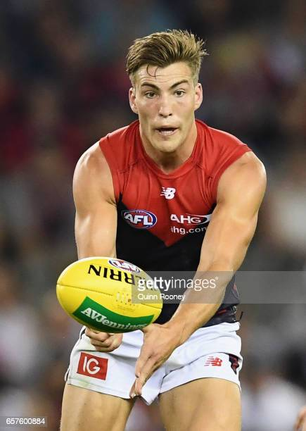 Jack Viney of the Demons handballs during the round one AFL match between the St Kilda Saints and the Melbourne Demons at Etihad Stadium on March 25...