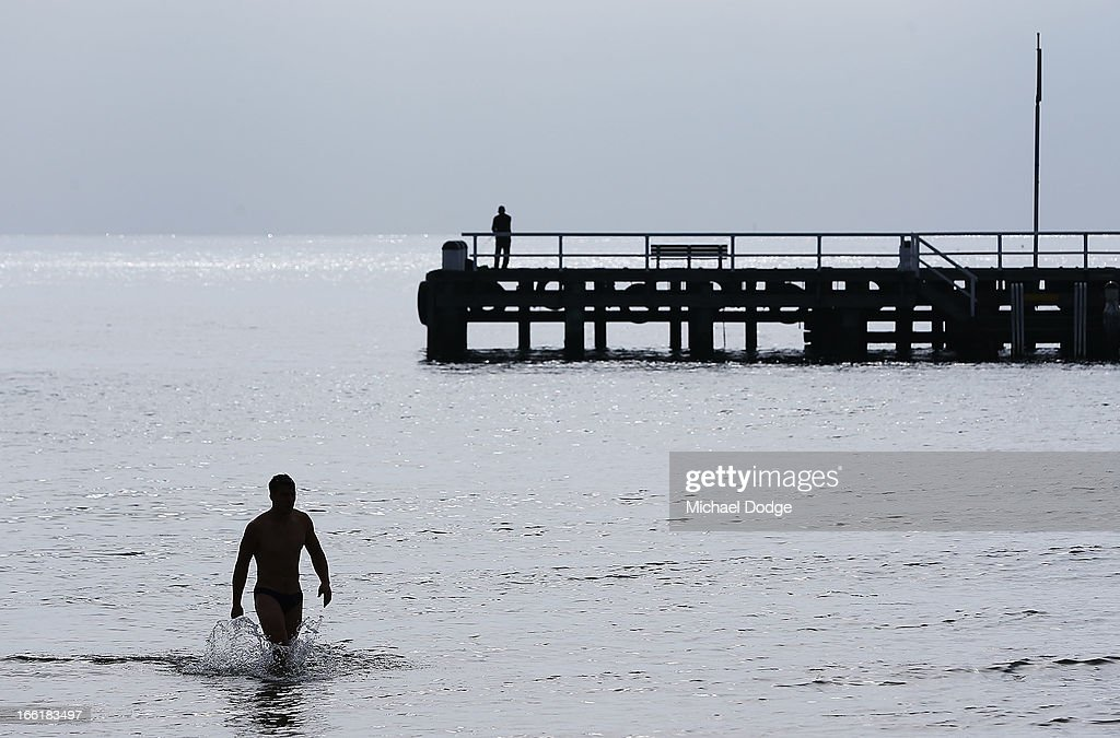 Jack Viney of the Demons is seen walking in the water in front of the Sorrento Pier during a camp for Melbourne Demons AFL players and coaching staff at Sorrento on April 10, 2013 in Melbourne, Australia.