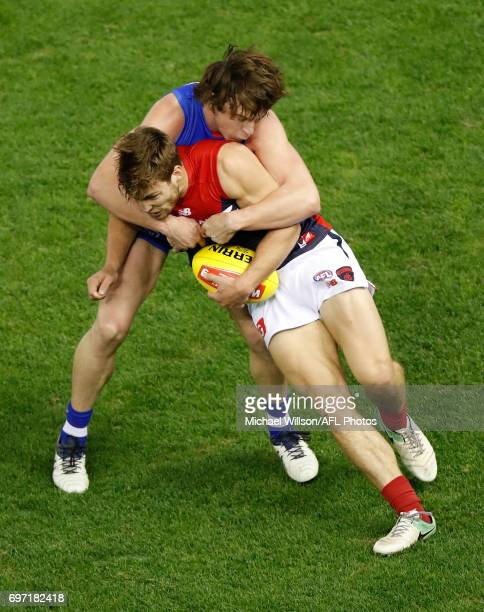 Jack Viney of the Demons is tackled by Liam Picken of the Bulldogs during the 2017 AFL round 13 match between the Western Bulldogs and the Melbourne...