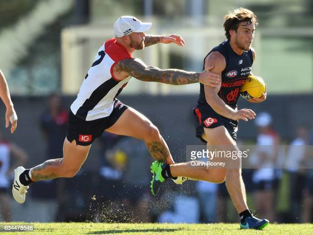 Jack Viney of the Demons is tackled by Nathan Jones of the Demons during the Melbourne Demons AFL IntraClub match on February 10 2017 in Melbourne...
