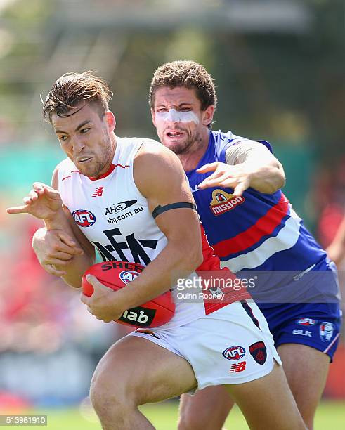 Jack Viney of the Demons is tackled by Tom Liberatore of the Bulldogs during the 2016 AFL NAB Challenge match between the Western Bulldogs and the...