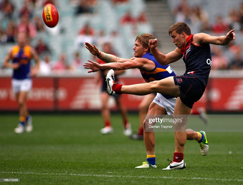 Jack Viney of the Demons kicks the ball during the round three AFL match between the Melbourne Demons and the West Coast Eagles at Melbourne Cricket Ground on April 13, 2013 in Melbourne, Australia.