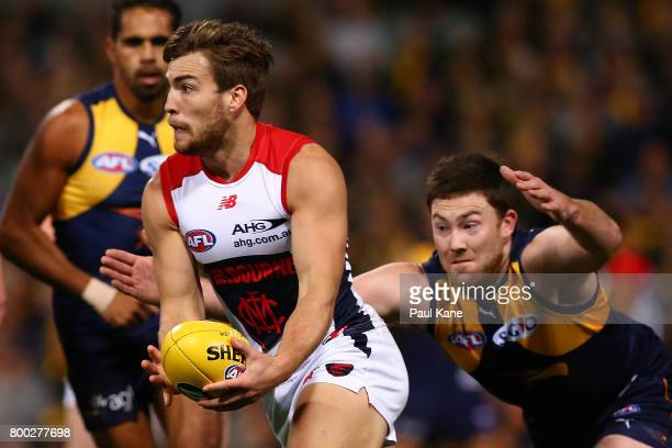 Jack Viney of the Demons looks to handball during the round 14 AFL match between the West Coast Eagles and the Melbourne Demons at Domain Stadium on...