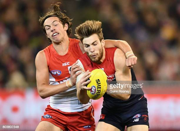 Jack Viney of the Demons marks infront of Oliver Florent of the Swans during the round 15 AFL match between the Melbourne Demons and the Sydney Swans...