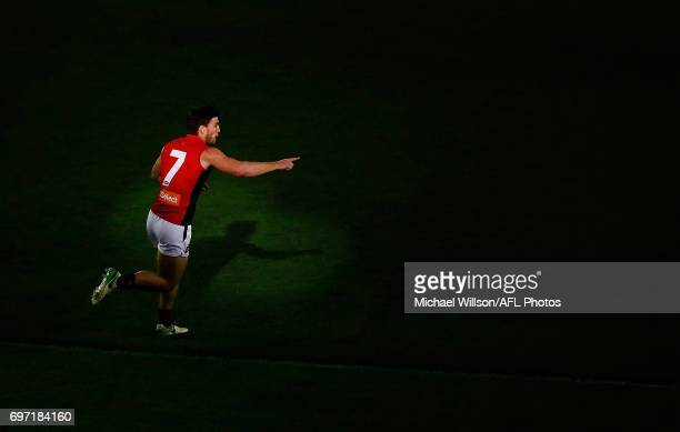 Jack Viney of the Demons points to position during the 2017 AFL round 13 match between the Western Bulldogs and the Melbourne Demons at Etihad...