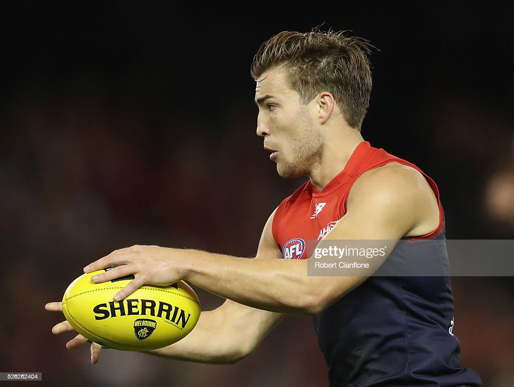 Jack Viney of the Demons runs with the ball during the round six AFL match between the Melbourne Demons and the St Kilda Saints at Etihad Stadium on April 30, 2016 in Melbourne, Australia.