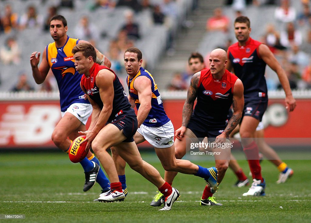 Jack Viney of the Demons runs with the ball during the round three AFL match between the Melbourne Demons and the West Coast Eagles at Melbourne Cricket Ground on April 13, 2013 in Melbourne, Australia.