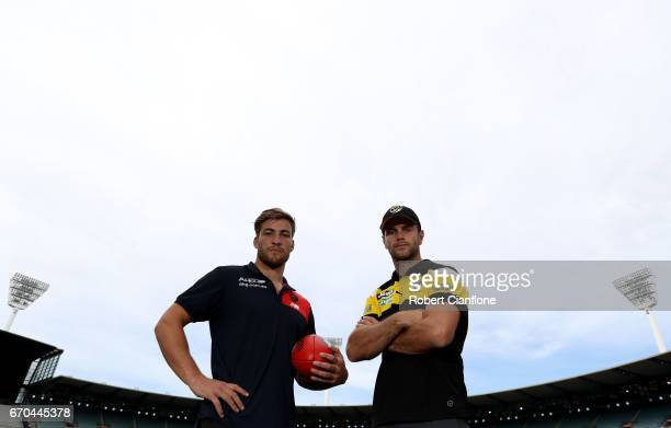 Jack Viney of the Melbourne Demons and Trent Cotchin of the Richmond Tigers pose during a Richmond Tigers AFL media session at ME Bank Centre on...