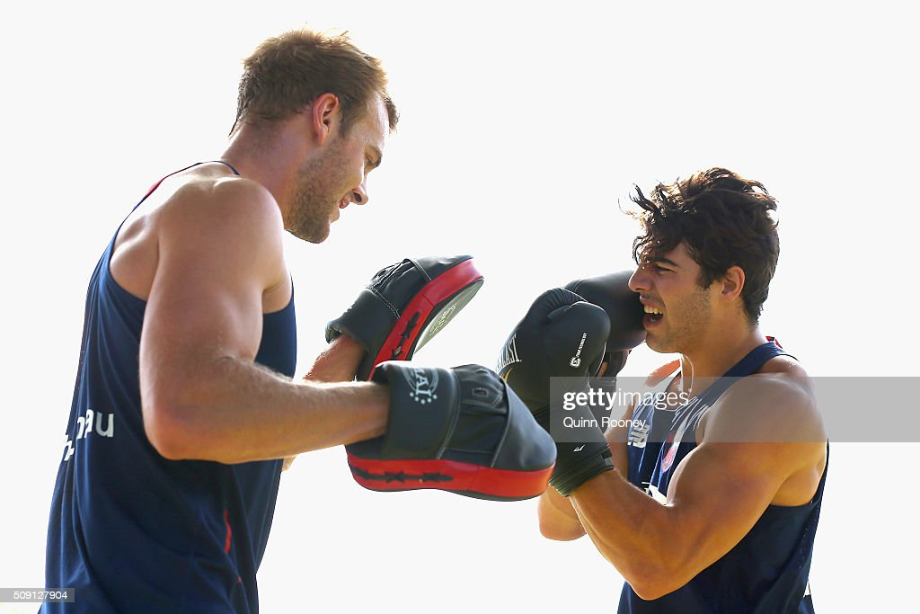 Jack Watts and Christian Petracca of the Demons box during a Melbourne Demons AFL pre-season training session at Gosch's Paddock on February 9, 2016 in Melbourne, Australia.