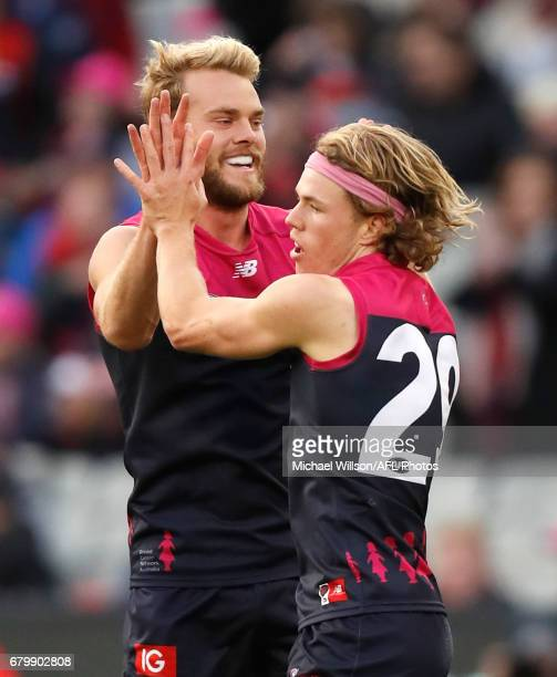 Jack Watts and Jayden Hunt of the Demons celebrate during the 2017 AFL round 07 match between the Melbourne Demons and the Hawthorn Hawks at the...