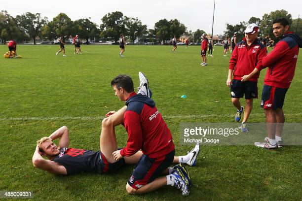 Jack Watts has a hamstring checked during a Melbourne Demons AFL training session at Gosch's Paddock on April 16 2014 in Melbourne Australia