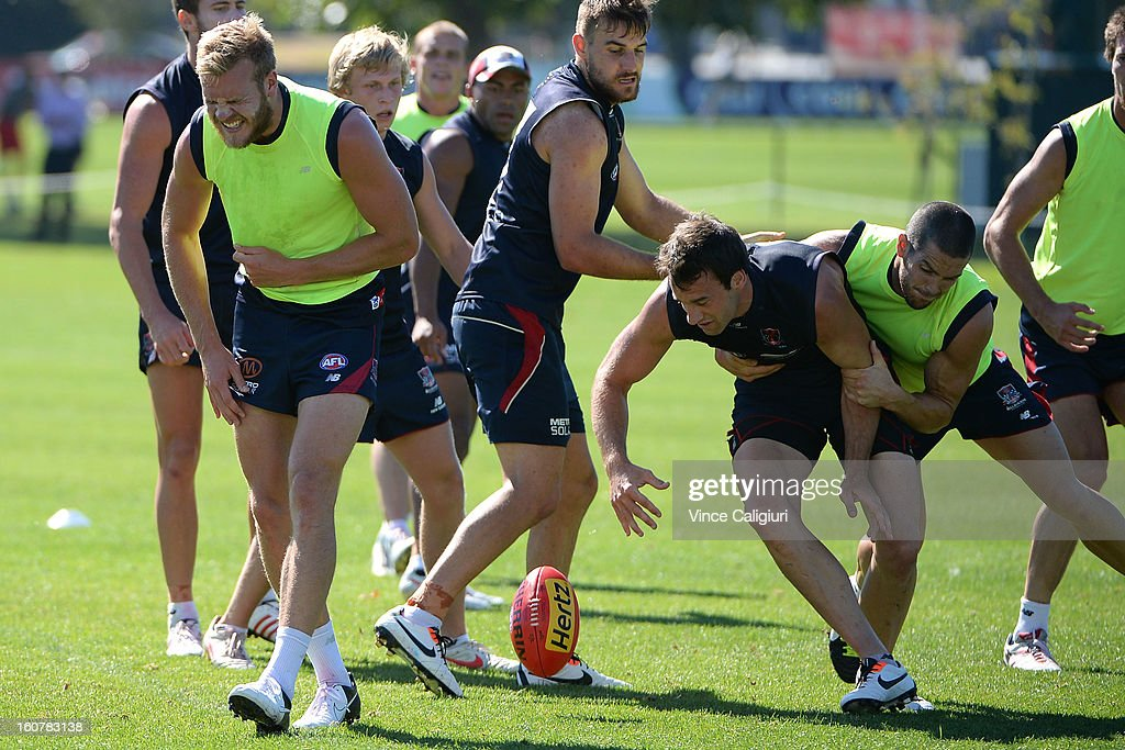 Jack Watts (L) is out of breath after being winded during a Melbourne Demons AFL training session at Gosch's Paddock on February 6, 2013 in Melbourne, Australia.