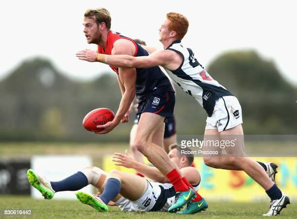 Jack Watts of Casey handballs during the round 16 VFL match between Casey and the Northern Blues at Casey Fields on August 12 2017 in Melbourne...