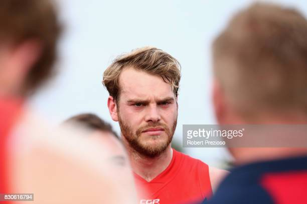 Jack Watts of Casey listens to the coach during the round 16 VFL match between Casey and the Northern Blues at Casey Fields on August 12 2017 in...