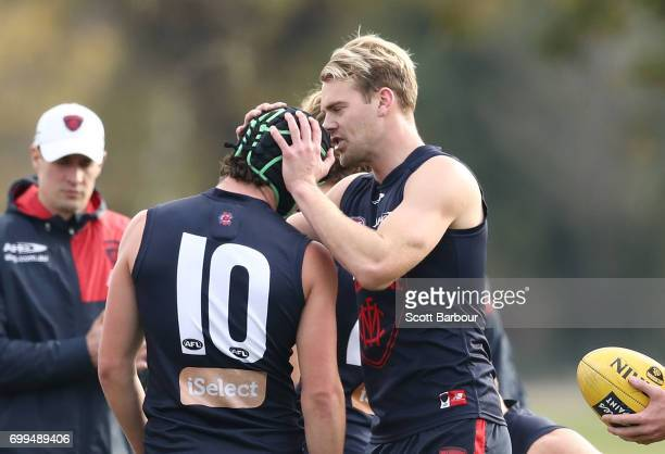 Jack Watts of the Demons and Angus Brayshaw of the Demons talk during a Melbourne Demons AFL training session at Gosch's Paddock on June 22 2017 in...